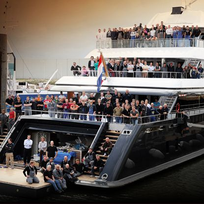Stern view of M/Y ICON with ICON Yachts staff covering all decks.