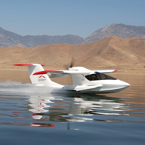 ICON A5 folding-wing amphibious aircraft taking off at sea.