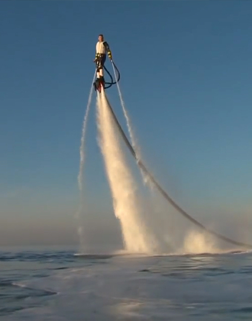 Man hovers high above sea on water jets using the Flyboard.