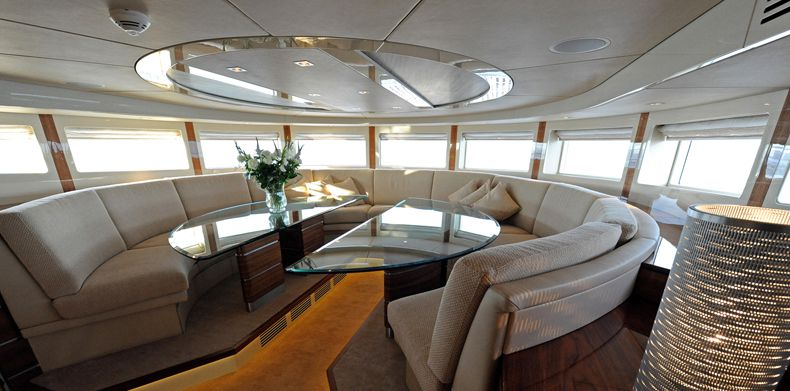 Circular seating and glass table on superyacht Basmalina II.