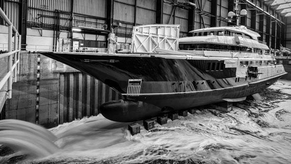 Inspecting a hull at ICON Yachts shipyard.