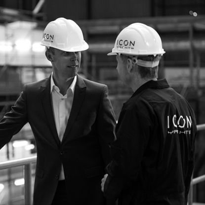 Two men talking in ICON Yachts dry dock.